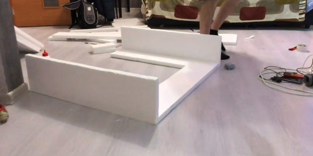 Decorative fireplace with your own hands: cut out two rectangles from polystyrene foam and stick to the workpiece to form lateral parts