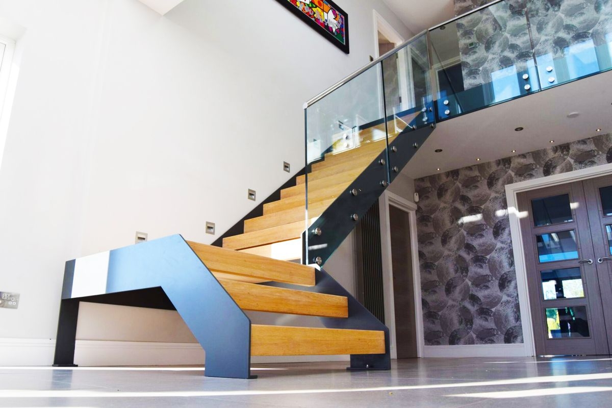 Staircase Renovation How To Design A Staircase Real Homes   Glass Balustrade Staircase Cost   Tempered Glass Panels   Stair Treads   Oak Staircase   Curved Glass   Stainless Steel