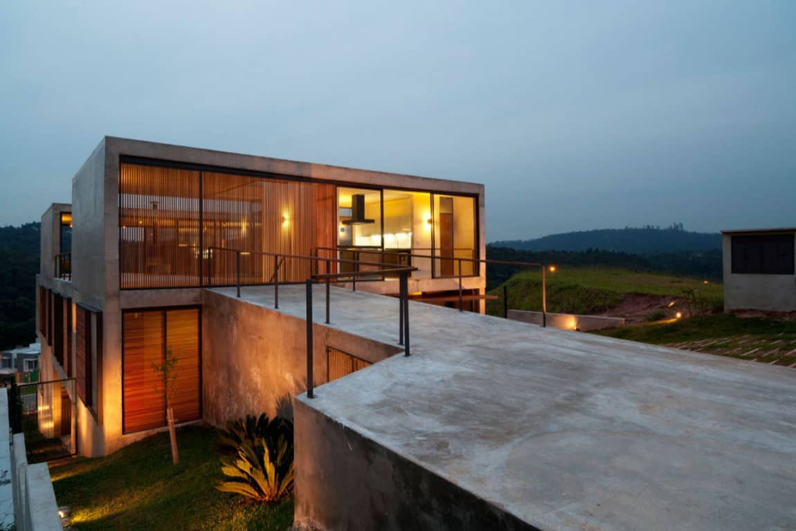 Hillside House With 2 Concrete Volumes 2nd Story Entrance
