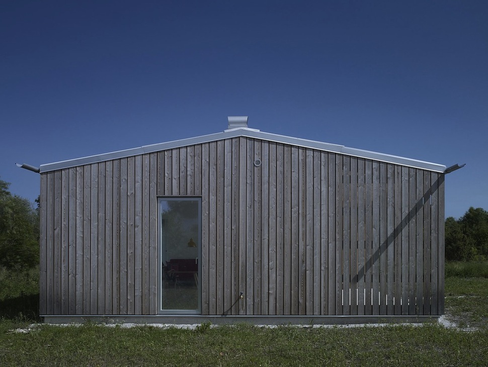 Small Swedish House Made From Boards And Corrugated Metal View in gallery small swedish house made from boards corrugated metal