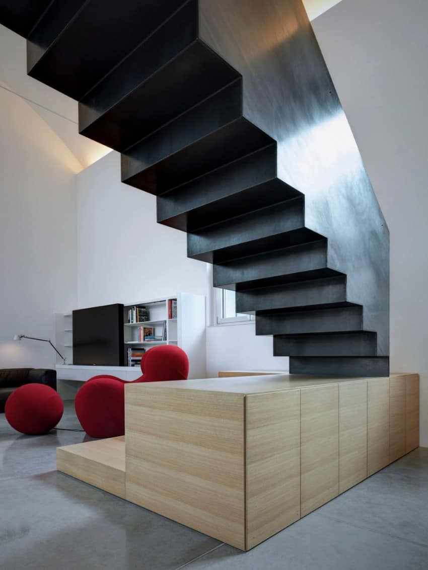 Buratti Architetti Makes Massive Black Metal Staircase Fit
