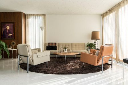 Living room rug ideas and tips  How to choose the right one   Curbed The living room of the house is white with accent walls of wood veneer   Midcentery
