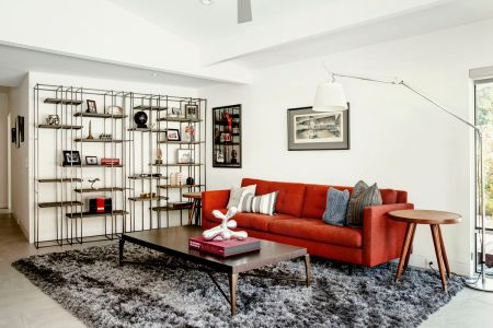 Living room rug ideas and tips  How to choose the right one   Curbed A large shag rug anchors the den TV room of a remodeled midcentury modern  home in Sacramento  CA  Photo by Carlos Chavarria      Curbed Handbook