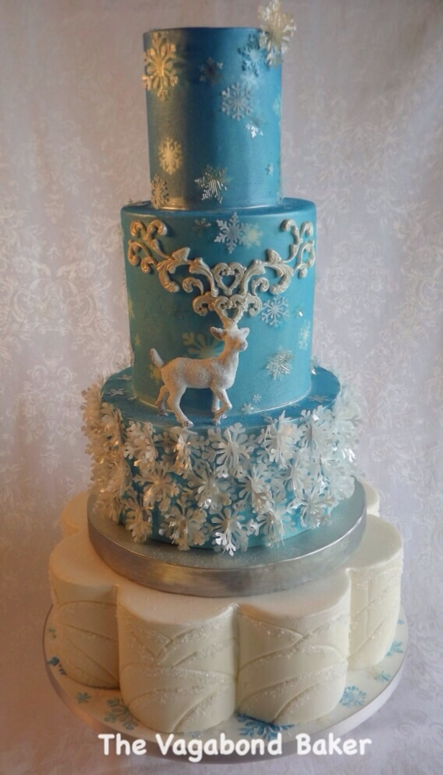 Reindeer And Snowflakes Wedding Cake The Snowflake Layer Is Is Wafer     Reindeer and Snowflakes Wedding cake  The snowflake layer is is wafer  paper  the snowflakes on the top tiers are gelatin or wafer paper