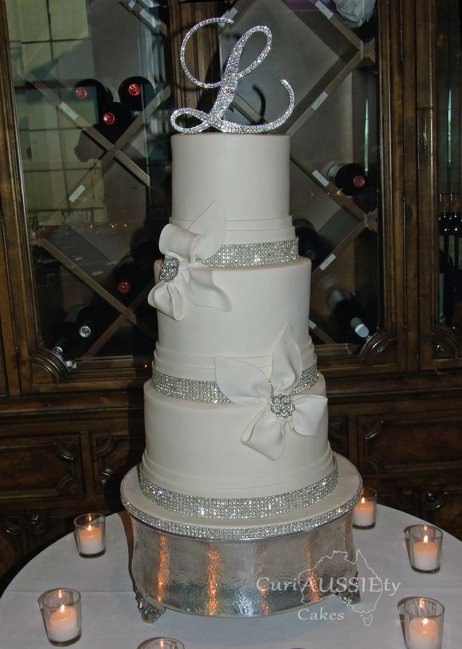 Elegant White Bow And Bling Wedding Cake Cakecentral Com