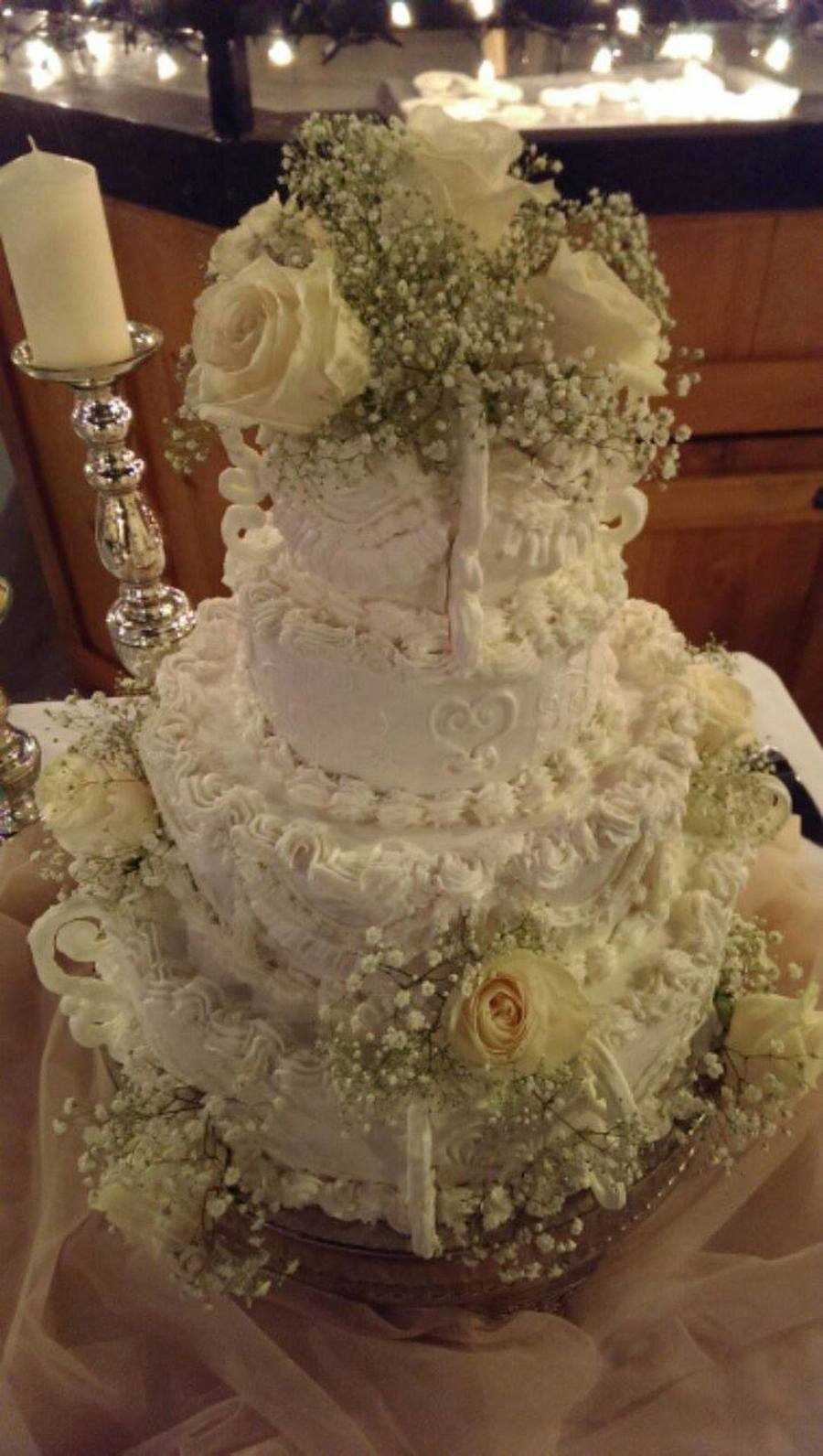 This Beautiful Wedding Cake Is Adorned With Flowers And