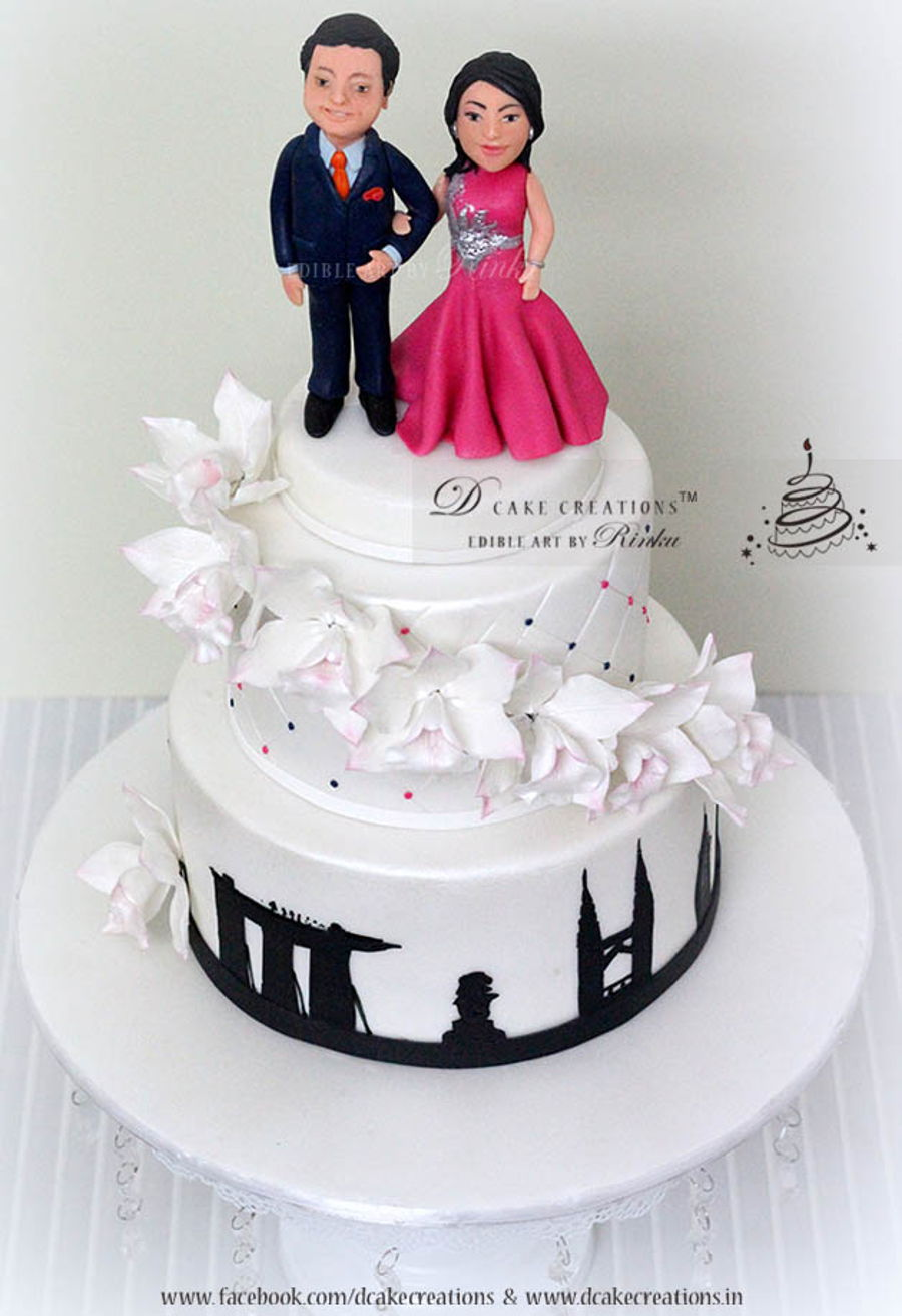 Personalised Engagement Cake   CakeCentral com The Engagement Cake was personalised with the couples figurine dressed in  their party costumes  The middle tier was decorated with Orchid Climber s