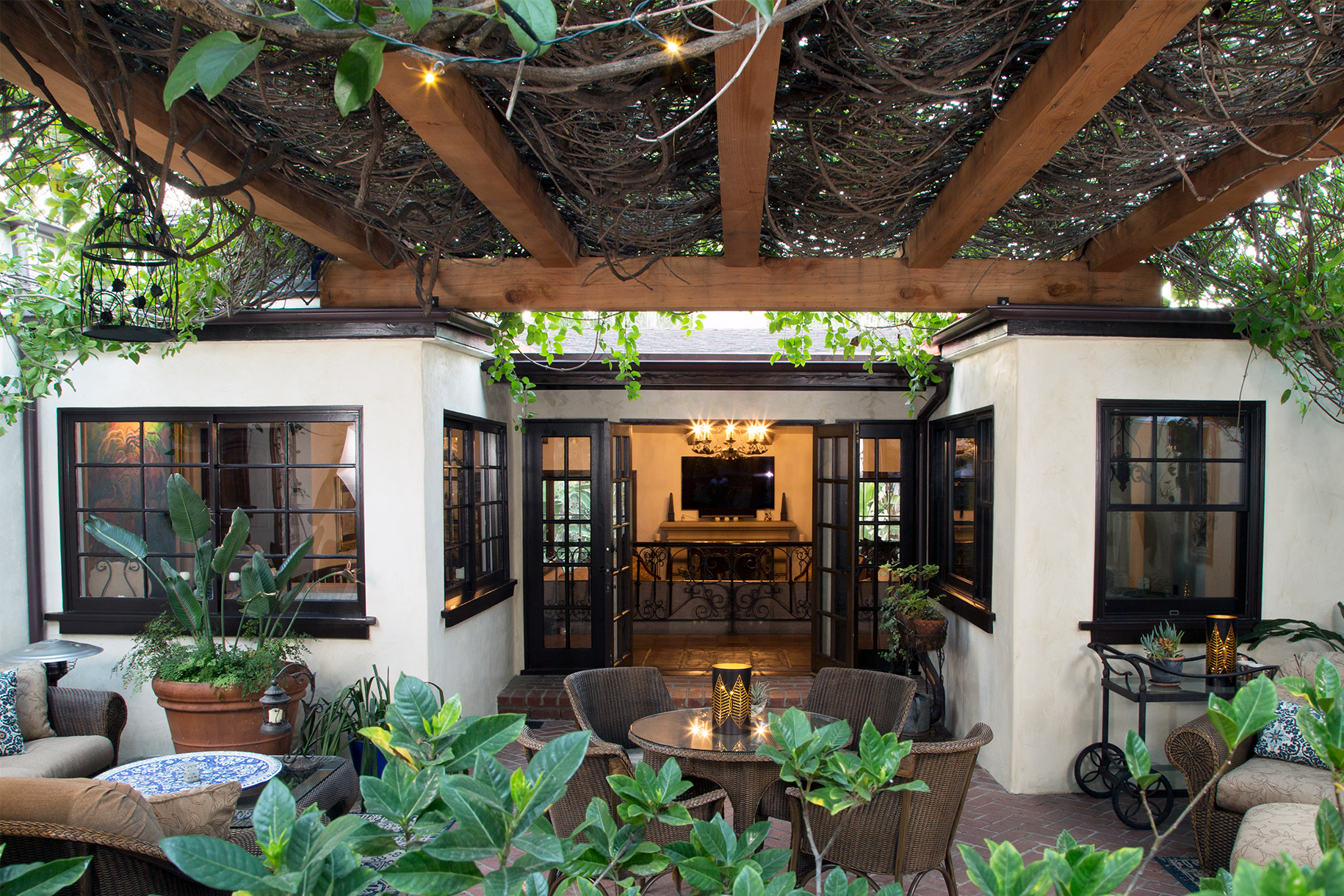Expansive Redwood Timber Pergola Creates Verdant Courtyard