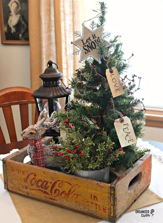 Stunning Primitive Christmas Decorations Ideas   Christmas     Packed in an authentic coke box this tabletop decoration of Christmas  berries a reindeer and pine tree symbolizes the feelings of peace and love  at