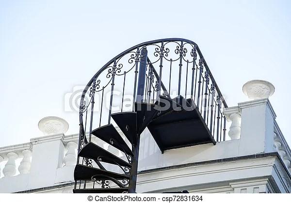 Beautiful Wrought Iron Exterior Spiral Staircase On The Side Of A | Wrought Iron Spiral Staircase | Wood | Gothic | Small | Mezzanine | Internal