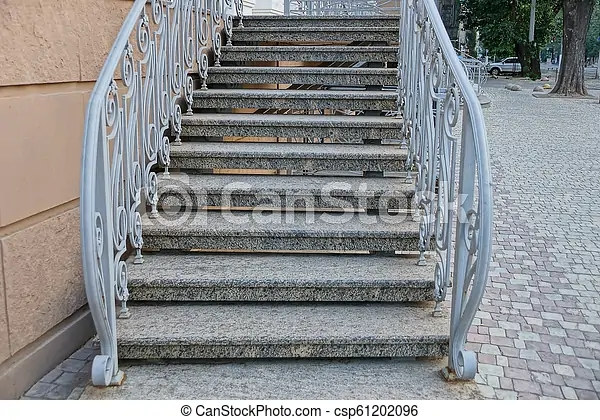 Gray Concrete Steps Of The Stairs With Handrails Near The Wall Of   Handrails For Concrete Steps   Concrete Surface Mount Stair Railing   Back Patio   Premade   Landing   Deck Stair