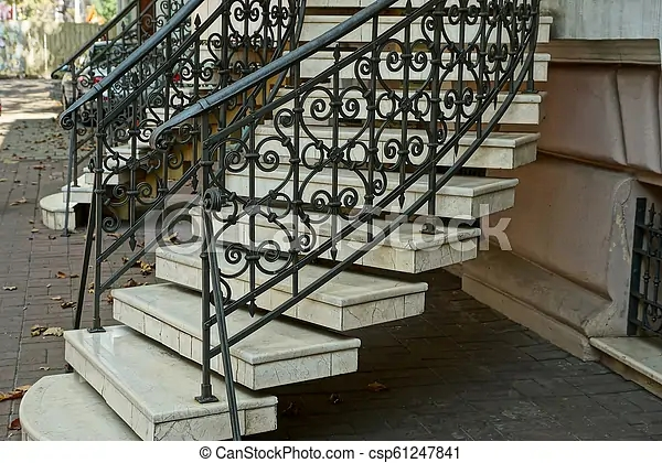 Staircase With Gray Concrete Steps And Iron Black Handrails With A | Building A Handrail For Concrete Stairs | Deck Railing | Deck | Steel Handrail | Porch | Outdoor Stair