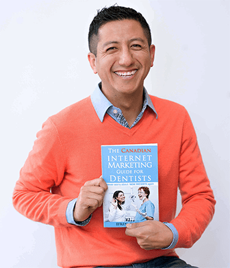 Efren holding his book: The Canadian Internet Marketing Guide for Dentists