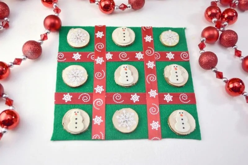 DIY Christmas Tic Tac Toe Board Game Craft This DIY Christmas Tic Tac Toe board is an easy to make holiday craft  perfect for