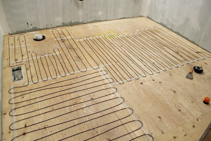 How to install a heated tile floor     and also how NOT to install a     How to install heated tile floors in your home  Learn how to avoid all the