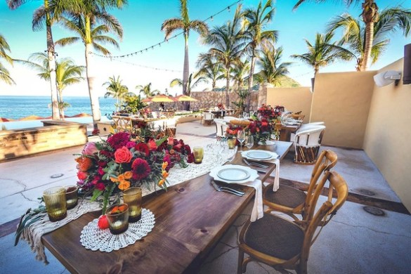 Rustic Destination Wedding with Touching Details on Beach in Mexico         rustic wooden tablescapes with low colorful centerpieces lace runners  at beach venue mexico
