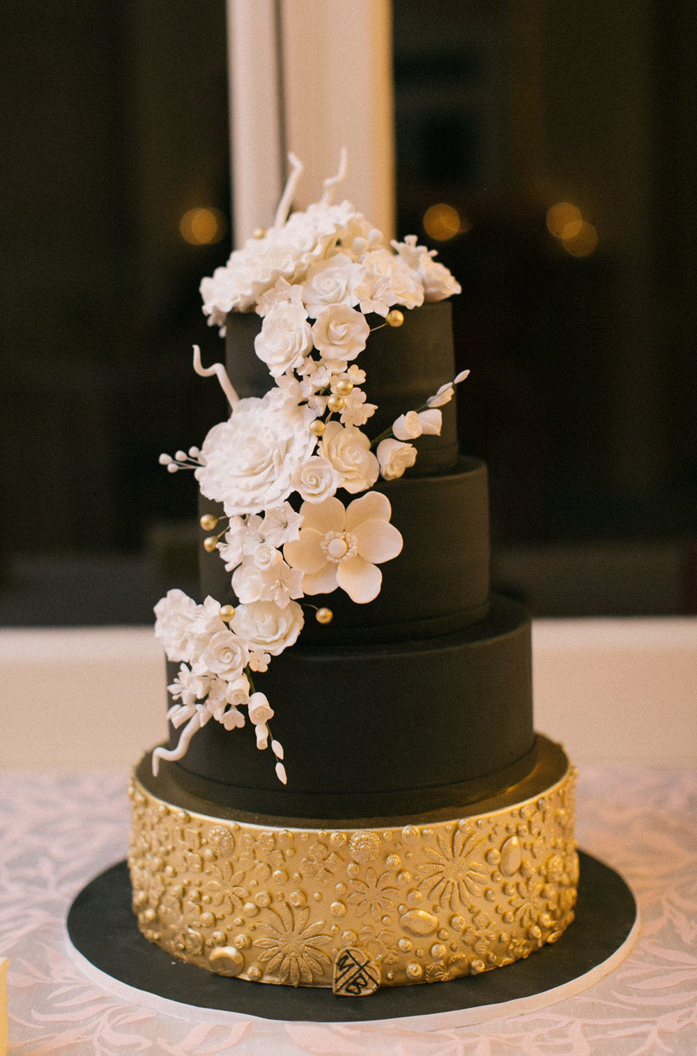 Wedding Cake Ideas  Unique   Beautiful Cakes Large and Small     Unique black wedding cake with white flowers and gold base wedding cake  ideas