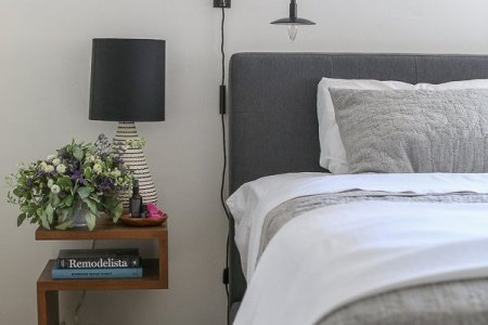 How to Make a Bedroom Cozy   Crate and Barrel Blog Bed with grey bedspread  shag rug  bedside table with lamp and flowers  and