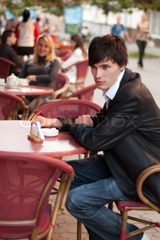 Man In Cafe Outdoor Waiting For Coffee Stock Photo