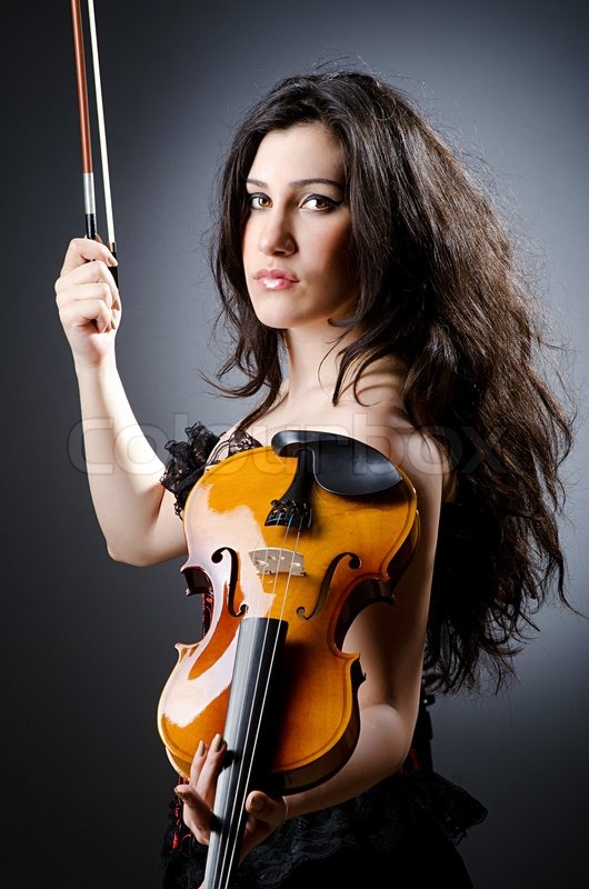 Female violin player against background | Stock image ...