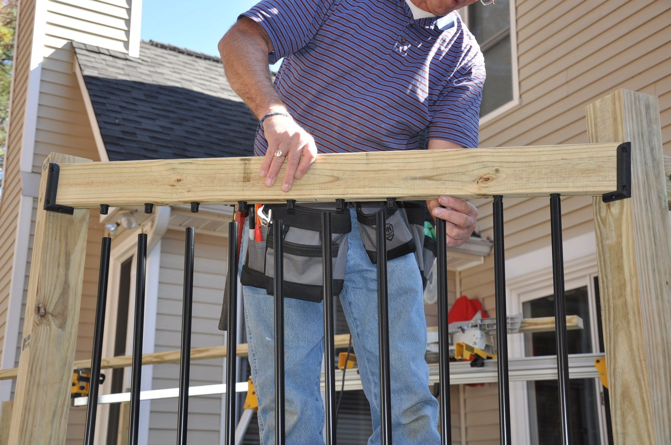 How To Install Deck Rail Balusters Decks Com   Wood Baluster Deck Railing   Temporary   Surface Mount   Pre Built   Side Mounted   Hardwood