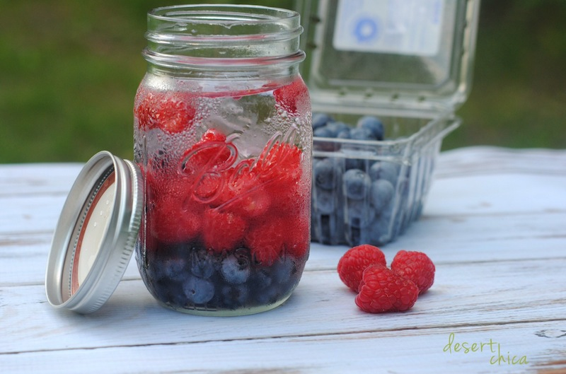 Raspberry infused water combined with Blueberry infused water create the ultimate detox drink. Learn how to make a blueberry and raspberry infused water recipe.