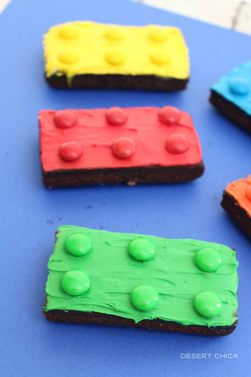 Red, and green decorated brownies that look like LEGO bricks