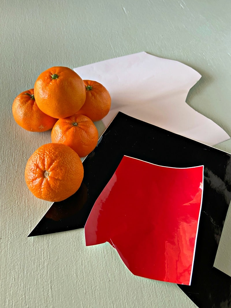 oranges and scraps of red, black and white vinyl
