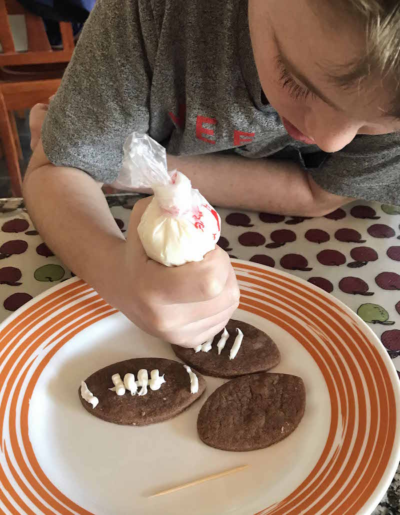 Let kids decorate chocolate football cookies for a fun football activity for kids