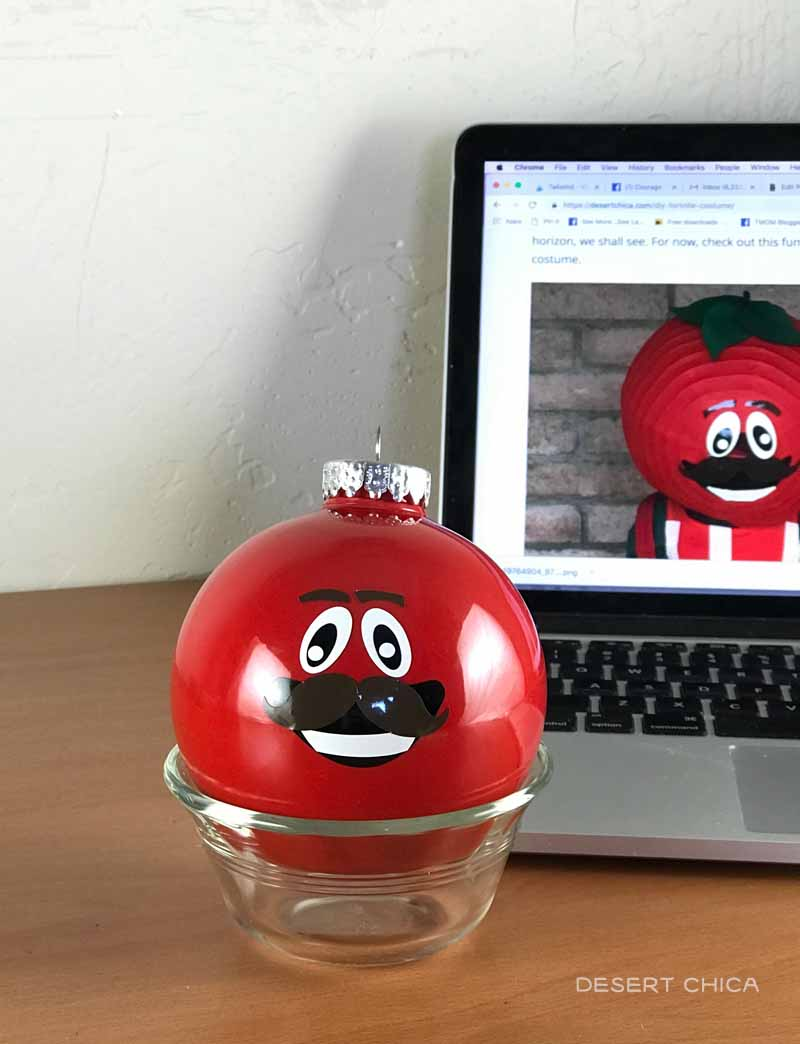 Use an image of the Tomato Head to help place the face on the Fortnite Ornament