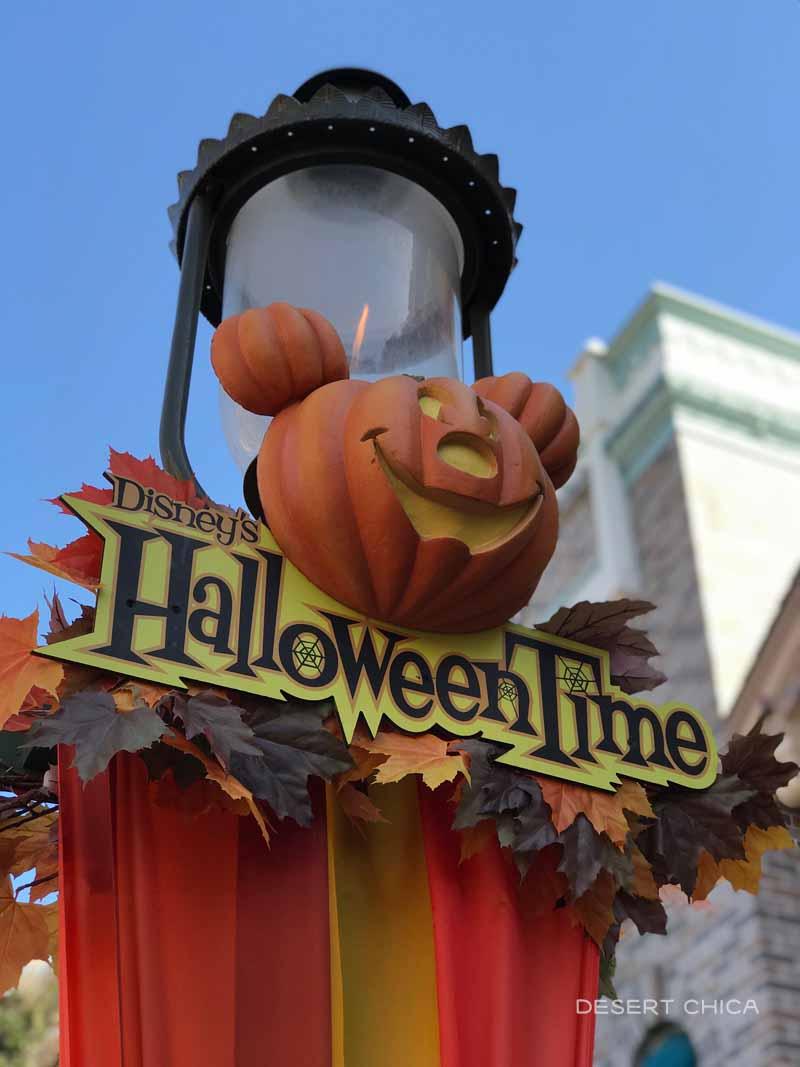 HallowenTime sign at Disneyland featuring a mickey head pumpkin
