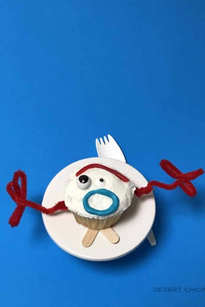One forky cupcake on a cupcake stand with a spork behind it.