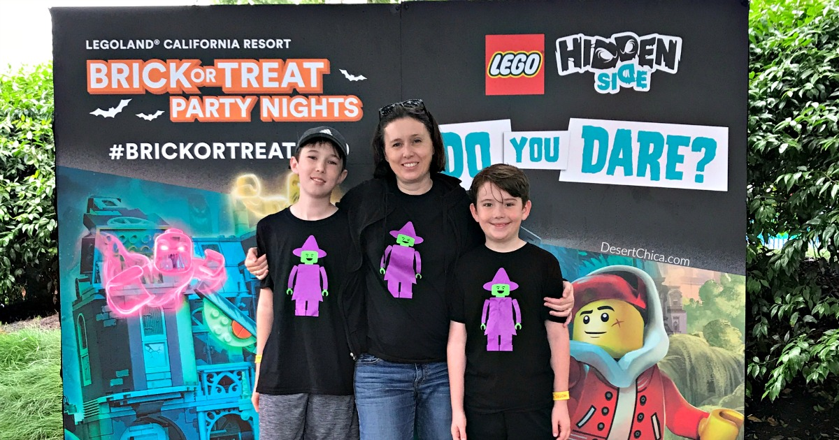 mom and 2 kids wearing black shirts with LEGO witch minifigures