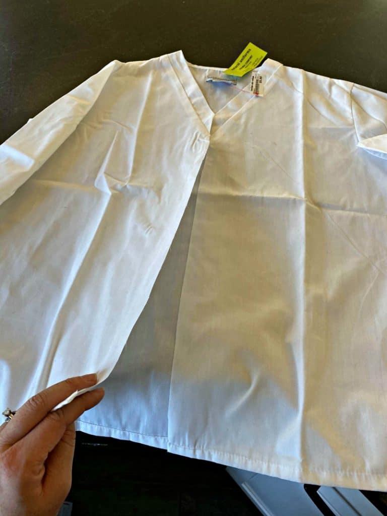 white medical scrub shirt cut down the middle
