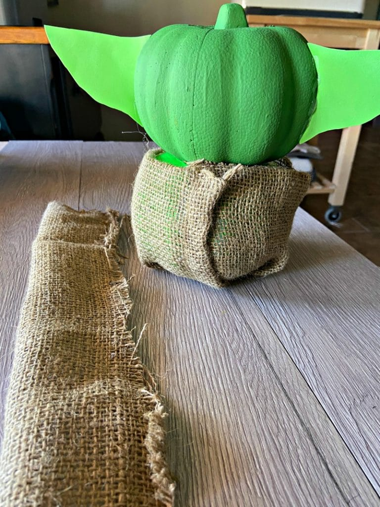 Add burlap to create Baby Yoda Robe on Pumpkin craft