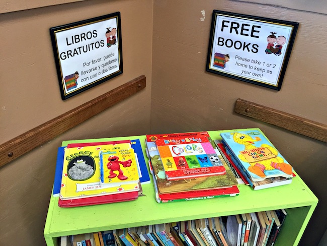 books on a bookshelf at ICS Food Bank Tucson