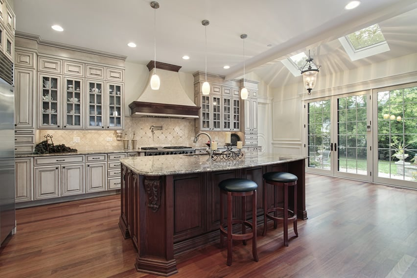 35 Beautiful White Kitchen Designs  With Pictures    Designing Idea Luxury white kitchen with elegant glass faced cabinetry and wood flooring