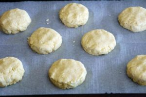 Use your finger tips to gently pressing the dough mounds down.