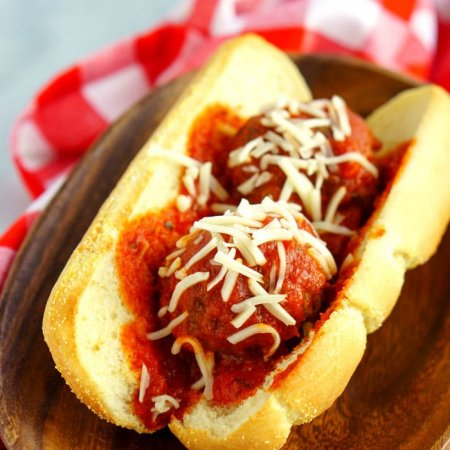 Close up picture of a meatball sub sandwich on a butter roll.