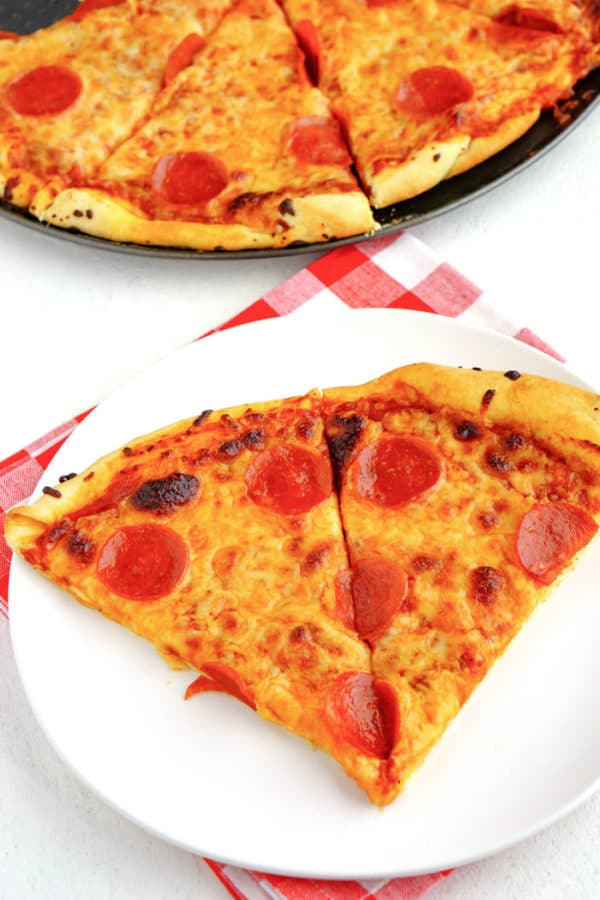 2 Slices of pepperoni pizza on a plate.