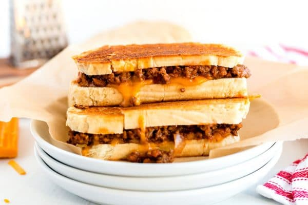 2 grilled cheese sandwiches stacked on top of each other.