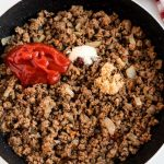Add the ketchup and other ingredients to the ground beef.