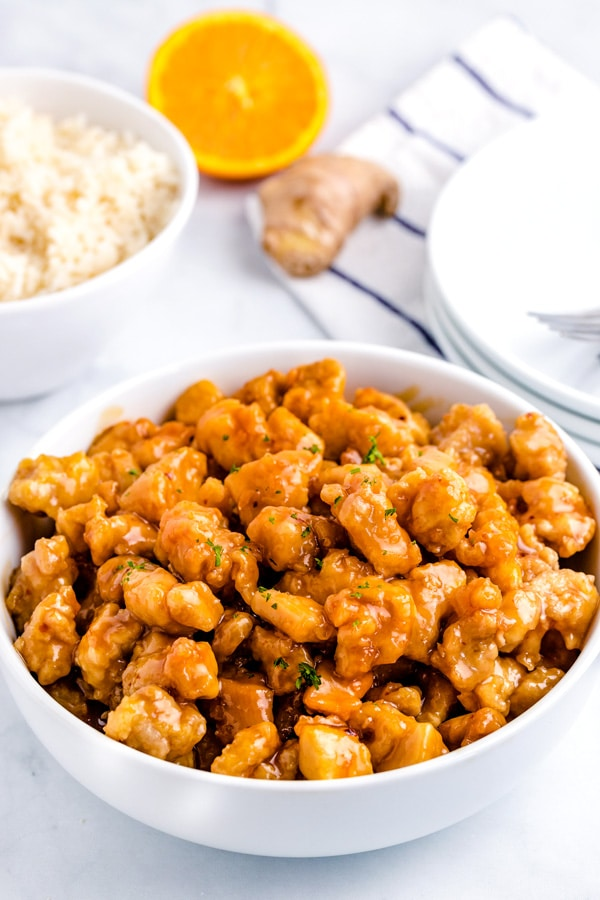 A bowl full of finished orange chicken.