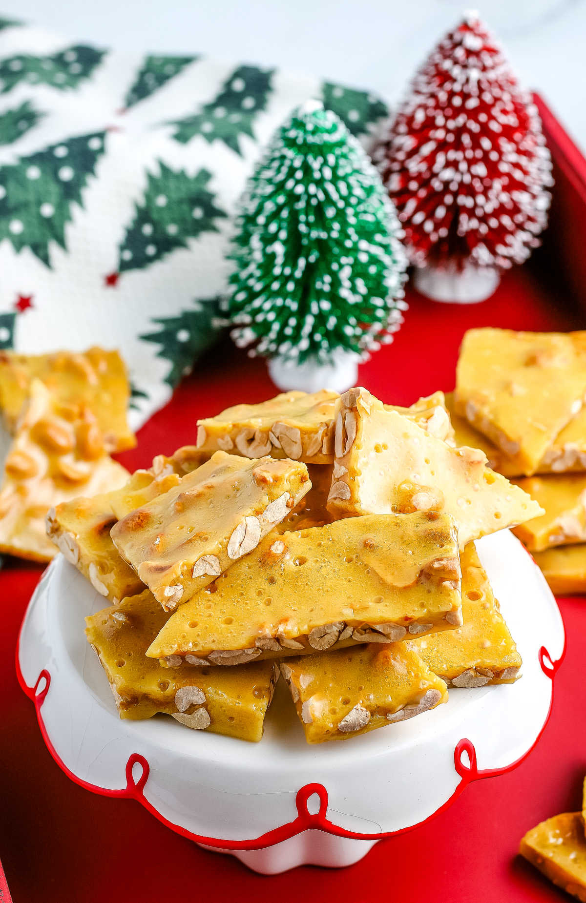Homemade Peanut Brittle is a sweet, salty, and crunchy candy that is made on the stovetop. It's one of our favorite edible gifts to give during the holidays. via @easybudgetrecipes