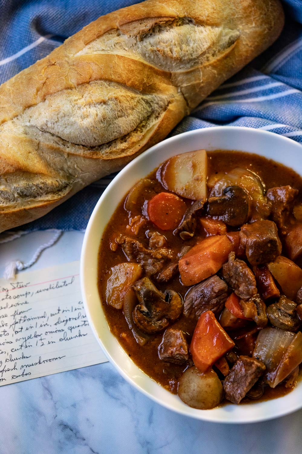 The finished Gone All Day Stew with grandpa's handwritten recipe on an index card.