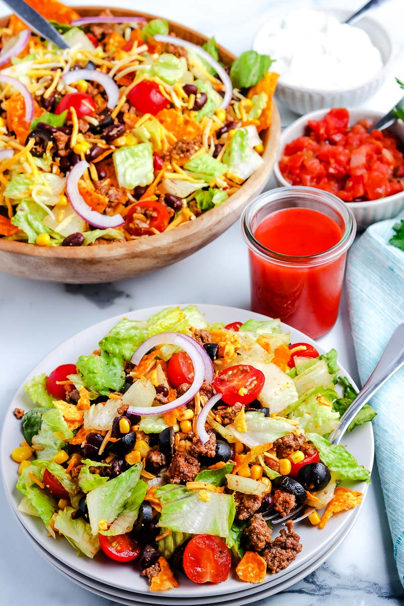Dorito Taco Salad on a plate with Catalina Dressing in a jar.
