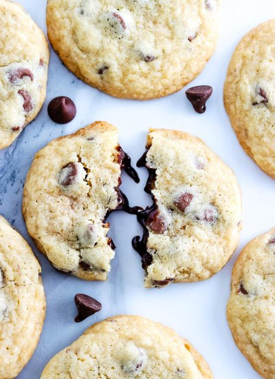 a close up picture of a Copycat Mrs. Field's Chocolate Chip Cookies broken in half.