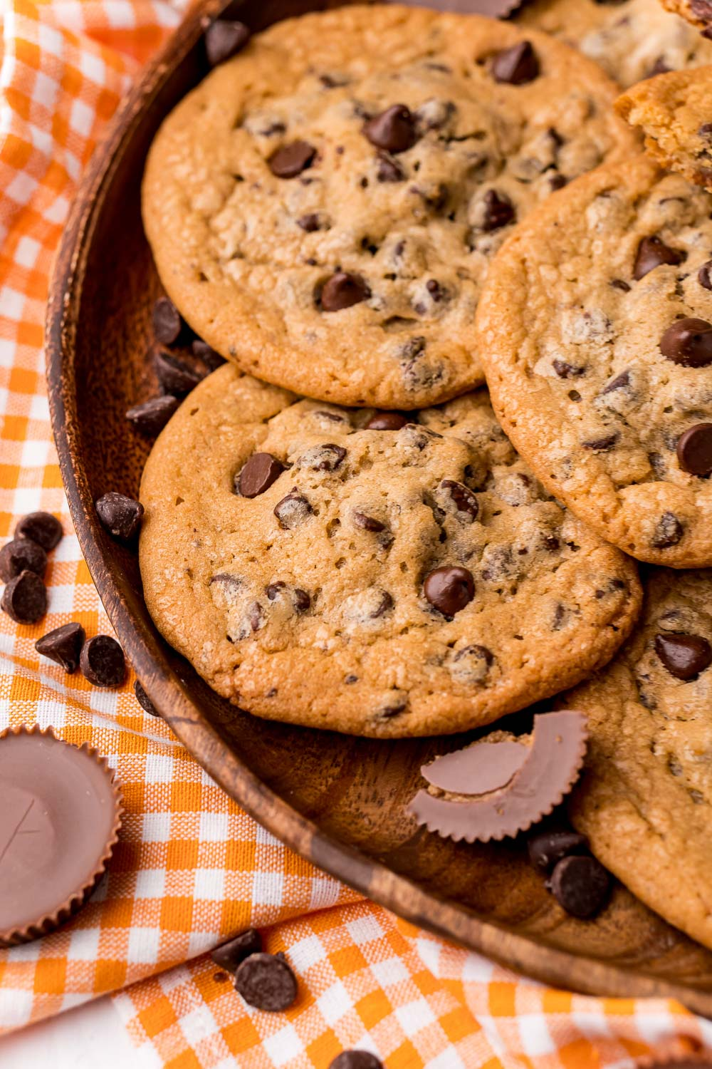 A close up picture of Reese's Stuffed Cookies on a wooden platter.