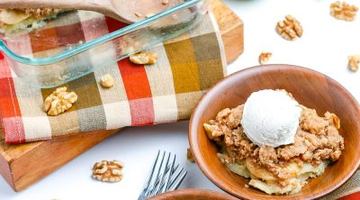 Easy Apple Crisp in a backing dish and in wooden bowls with ice cream on top.