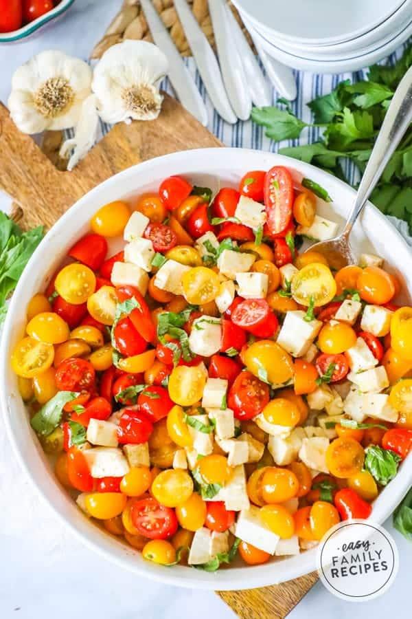 Sweet and savory Tomato Bail Mozzarella Salad.